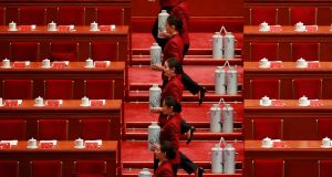Stewardesses prepare tea flasks for delegates before the opening ceremony of the  Communist Party congress. Photograph: How Hwee Young/EPA