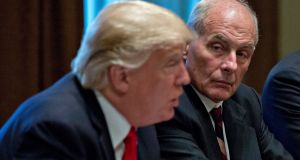 US president Donald Trump and White House chief of staff John Kelly. Mr Kelly's son, like the retired general a US marine, died in Afghanistan in 2010. Photograph: Andrew Harrer/EPA