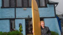 Marc Ó Riain outside his Kinsale home with his Ecuadorian balsa surfboard, a favourite item. Photograph: Michael Mac Sweeney/Provision