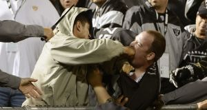 Two fans fight during a Chargers and Raiders game at Oakland-Alameda County Coliseum. Photograph: Thearon W. Henderson/Getty Images