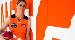 Cora Staunton in the colours of the GWS Giants' AFLW team.