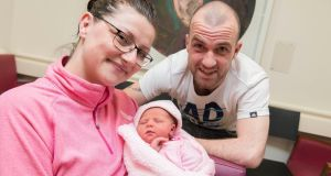 Sonya Burke and Colm O'Callaghan, from Crosshaven, with their new baby Maria  who was born during Storm Ophelia. Photograph:  Michael Mac Sweeney/Provision