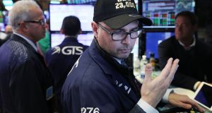 A trader on the floor of the New York Stock Exchange. Photograph: Spencer Platt/Getty Images