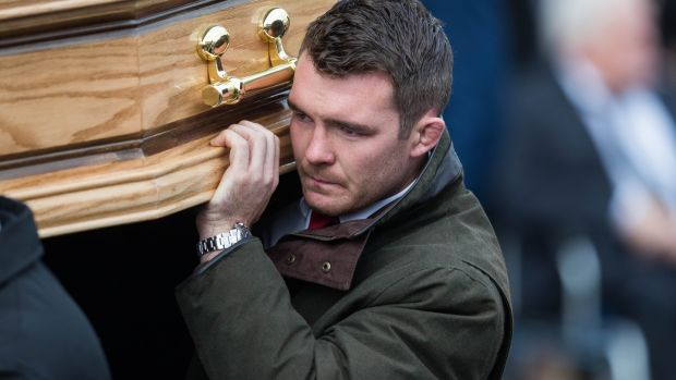 Peter O'Mahony carries the coffin of Anthony Foley at his funeral last October. Photo: Ryan Byrne/Inpho