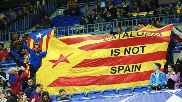 Barcelona fans show a Catalan independence flag during their win over Olympiacos. Photo: Alejandro Garcia/EPA