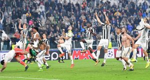 Juventus players celebrate after their Champions League win over Sporting Lisbon. Photo: Alessandro Di Marco/EPA