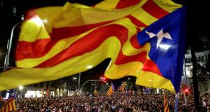 Thousands of people protest in downtown Barcelona on Tuesday. Photograph: Alberto Estevez/EPA
