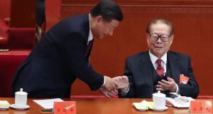 Chinese president Xi Jinping shakes hands with former president Jiang Zemin at the opening session of the Chinese Communist Party's congress on Wednesday.  Photograph:  Lintao Zhang/Getty Images