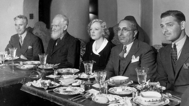 Charlie Chaplin, George Bernard Shaw, American actor Marion Davies, film producer Louis B Mayer and Clark Gable at an MGM lunch. Photograph: Hulton Archive/Getty Images