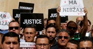 Murdered journalist's sons call on Malta's PM to resign