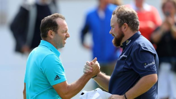 Sergio Garcia of Spain and Shane Lowry of Ireland shake hands on the 9th green at the end of their first rounds at the Andalucia Valderrama Masters at Real Club Valderrama in Cadiz, Spain. Photo: Warren Little/Getty Images