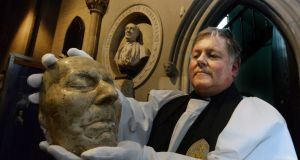 SWIFT FESTIVAL: Rev Dean William Morton with the death mask of Jonathan Swift at St Patrick's Cathedral, Dublin,  launching the Swift Festival, which marks the 350th anniversary of the writer's birth. It runs from November 23rd to 30th. Photograph: Cyril Byrne/The Irish Times