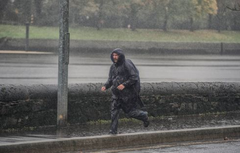 CORK RAIN: A pedestrian makes their way in heavy rain on Lower Glanmire Road, Cork city. Photograph: Michael Mac Sweeney/Provision