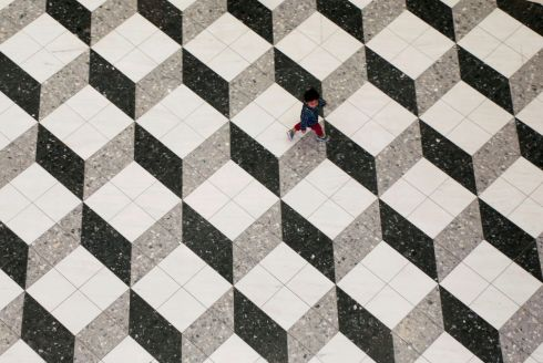BOXED OFF: A boy makes his way along at a shopping mall in Tokyo, Japan. Photograph: Toru Hanai/Reuters
