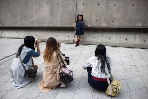 CENTRE OF ATTENTION: An child poses for photographers during Seoul Fashion Week at Dongdaemun Design Plaza in Seoul, South Korea. Photograph: Ed Jones/AFP/Getty Images