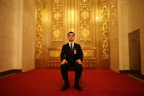 NO ENTRY: A Chinese security officer on guard during the 19th National Congress of the Communist Party of China, the country's most important political event, at the Great Hall of the People in Beijing. Xi Jinping is expected to remain as general secretary of the Communist Party of China for another five-year term. Photograph: Wu Hong/EPA