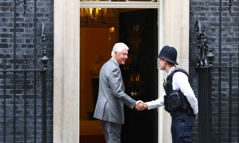 I'M BILL: Former US president Bill Clinton shakes hands with a London policeman on his arrival at the London residence of British prime minister Theresa May at No 10 Downing Street. Photograph: Neil Hall/EPA
