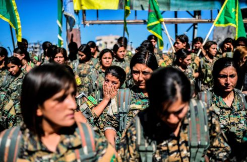 CALIPHATE  CRUMBLES: Female fighters with the Syrian Democratic Forces gather for a celebration at Al-Naim Square in Raqqa after taking control of the city from Islamic State fighters. Photograph: Bulent Kilic/AFP/Getty Images