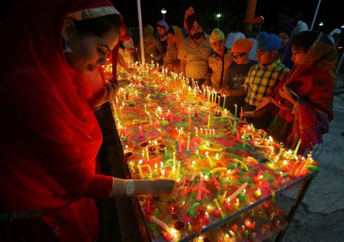 INDIAN LIGHTS: Devotees light candles at a Gurdwara, or Sikh temple, during celebrations to mark Bandi Chhorh Divas, which coincides with Diwali, the Hindu festival of lights, in Chandigarh, India. Photograph: Ajay Verma/Reuters