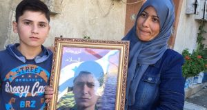 Wafa Mahmoud Yusif and her son Walid, with a photograph of her elder son, who was killed in the Syrian war. Photograph: Michael Jansen