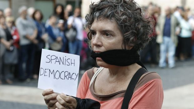 A protester during the protest gathering held at Sant Jaume square in Barcelona. Photograph: Andreu Dalmau/EPA