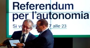 President of Lombardy Roberto Maroni discusses the voting system in the region's autonomy referendum with Forza Italia leader and former prime minister   Silvio Berlusconi in Milan on Wednesday. Photograph: Alessandro Garofalo/Reuters