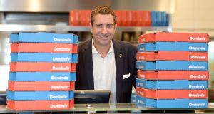 Simon Wallis, group COO of Dominos Plc, in their new outlet at Citywest . Photograph: Alan Betson