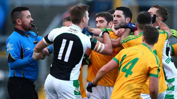 Referee Séamus Mulvihill tries to separate Kerry team-mates James O'Donoghue (Killarney Legion) and South Kerry's Bryan Sheehan after the 2015 final at Fitzgerald Stadium. Photograph: Cathal Noonan/Inpho