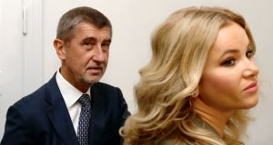 The leader of Ano party Andrej Babis and his wife Monika arrive to cast their votes in parliamentary elections in Prague on Friday. Photograph:  David W Cerny/Reuters