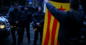 A demonstrator holds up an Estelada (Catalan separatist flag) during a gathering in Barcelona. Photograph: Ivan Alvarado/Reuters