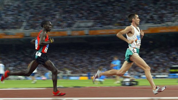 Ireland's Mark Carroll leads Eliud Kipchoge in the Men's 5,000m heats at the 2004 Olympic Games in Athens. Photograph: Patrick Bolger/Inpho