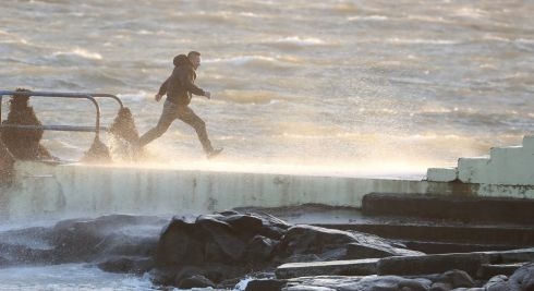 HARDY SOULS: Daredevils run out to a diving board at Salthill, Galway, as Storm Ophelia hits with gusts of up to 80mph. Photograph: Niall Carson/PA Wire