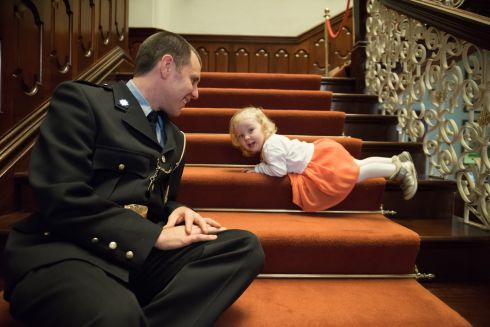 CERTIFIED BRAVE: Garda Alan Hayes with his daughter Aibhlinn, after he was awarded a bronze medal and certificate of bravery, along with colleagues, at the National Bravery Awards in Farmleigh House, Phoenix Park. Photograph: Barry Cronin