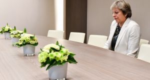 British prime minister Theresa May takes a seat as she arrives for a bilateral meeting with European Council president Donald Tusk during the EU summit in Brussels. Photograph: Geert Vanden Wijngaert/AFP/Getty Images