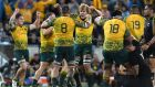 Australia celebrate their 23-18 victory over the All Blacks in Brisbane. Photograph: Dan peled/EPA