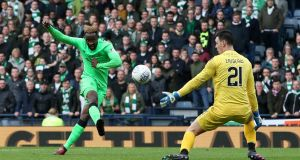 Celtic's Moussa Dembele scores his side's fourth goal  during the Betfred Cup, semi-final match against Hibernian at Hampden Park. Photograph:  Jane Barlow/PA Wire