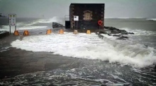 Strong winds and high waves pound Poolbeg Lighthouse