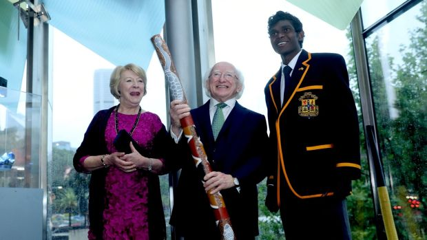 President Michael D Higgins and his wife Sabina speak with Leon Wunungmurra from Scots College, one of Australia's oldest and most respected schools, after he played a Aboriginal Didgeridoo welcome. Photograph: Maxwells