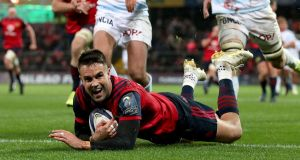 Munster scrumhalf  Conor Murray slides over to score his side's first try in the    Champions Cup match against Racing 92 at Thomond Park. Photograph: Dan Sheridan/Inpho