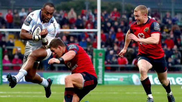 Joe Rokocoko of Racing 92 tries to run through the attempted tackle of Munster's Ian Keatley as Keith Earls also closes in during the Champions Cup game at Thomond Park. Photograph: Bryan Keane/Inpho