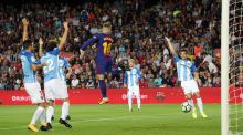 Barcelona's Gerard Deulofeu scores their first goal as Malaga players protest that the ball had gone out of play before it was crossed. Photograph: Albert Gea/Reuters