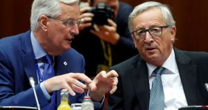 European Union chief Brexit negotiator Michel Barnier and European Commission president Jean-Claude Juncker: in some eyes, achievements are being made on the road to Brexit.  Photograph: Dario Pignatelli/Reuters