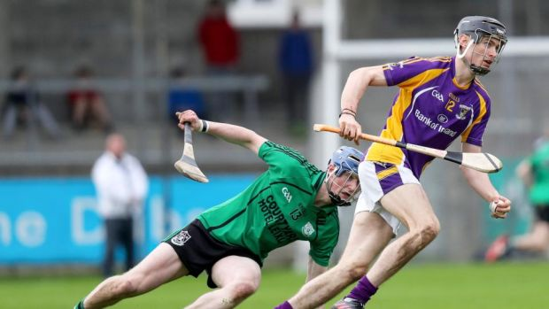 Kilmacud Crokes' Caolan Conway slips the challenge of Lucan Sarsfields' Ciaran Dowling during the Dublin SHC semi-final at Parnell Park. Photograph: Oisin Keniry/Inpho