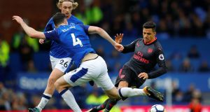 Arsenal's Alexis Sanchez in action with Everton's Michael Keane and Tom Davies. Photograph: Phil Noble/Reuters