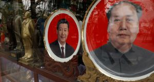 Souvenir plates with images of late Chinese Chairman Mao Zedong and Chinese President Xi Jinping in a shop during the congress of the Communist Party. Photograph: Tyrone Siu/Reuters