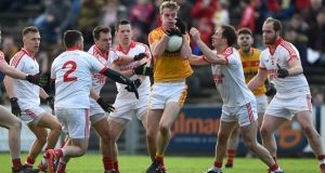 Danny Kirby holds off a number of Ballintubber players during Castlebar Mitchels' Mayo club SFC final win. Photograph: Tommy Grealy/Inpho