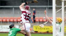 Slaughtneil's  Brian Cassidy in action against Ballygalget's Eoin Clarke and goalkeeper  Jamie Crowe during the  AIB Ulster Senior Hurling Club Championship Final at the  Athletic Grounds in Armagh. Photograph: Declan Roughan/Inpho