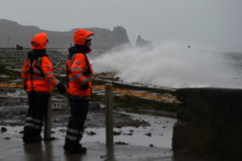 Members of the Irish Coast Guard stand on Howth Pier to prevent people walking along the structure. Photograph: Reuters/Clodagh Kilcoyne