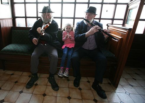 GETTING WARMED UP: Musicians Sean Ward, Cora O'Connell and Patsy Hanly in Cryan's Teach Ceoil, Carrick-on-Shannon, when details were announced of next weekend's Sessions at the Shannon traditional Irish music festival. Photograph: Brian Farrell