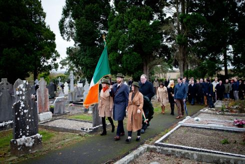 WOLFE TONE: Cllr Claire O'Connor, flag bearer Niall McEneaney and Cllr Emma Murphy at the Wolfe Tone  Commemoration at Bodenstown Cemetery, Co Kildare. Photograph: Tom Honan